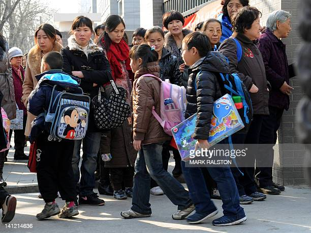 School children leave their elementary school at the end of classes in Beijing on March 13 2012 China has long been known for its highly disciplined...