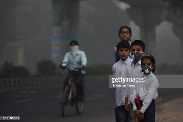 School children leaving for school amid heavy smog on November 8 2017 in New Delhi India Delhi was enveloped in a thick blanket of haze for the...
