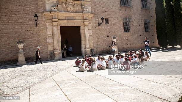 School children listen to their teacher on an educational visit to the historic sites of Granada Spain