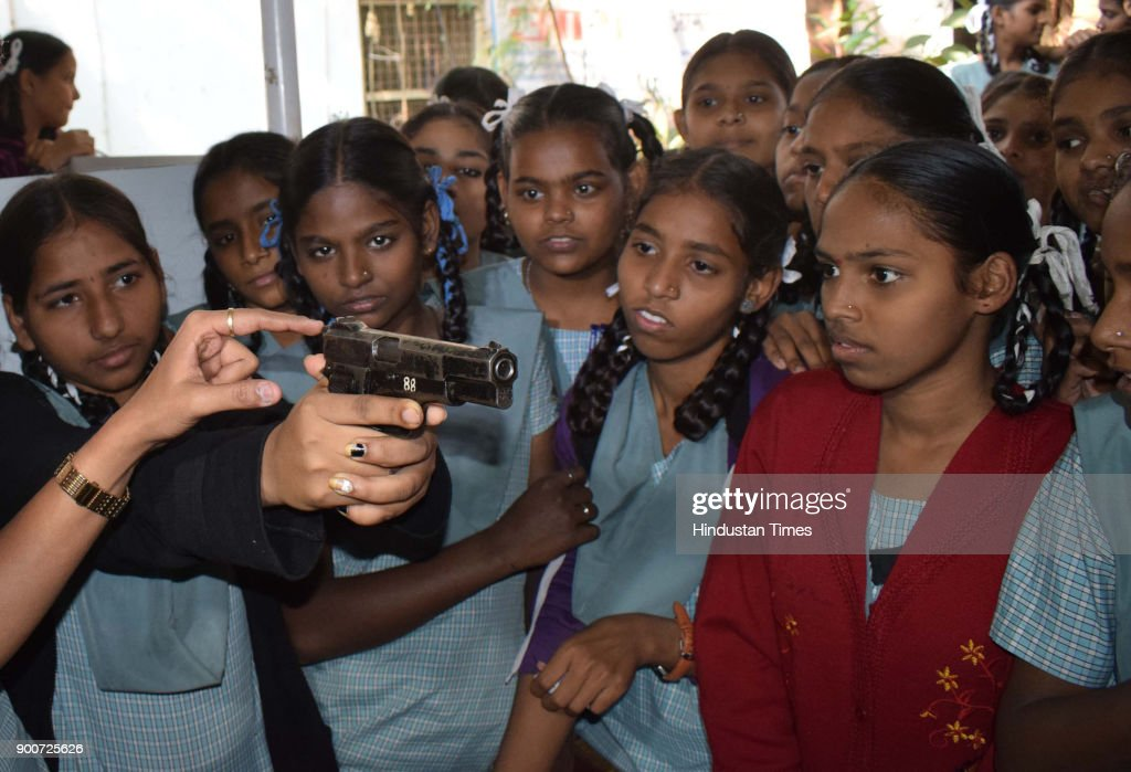 School children look weapons on the occasion of Police Raising Day, organised by the Thane Police at Thane nager Police Station, India, on January 2, 2018 in Mumbai, India.