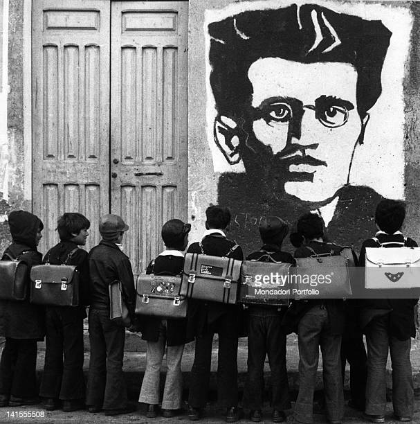 School children looking at a mural portraying Antonio Gramsci Orgosolo 1975