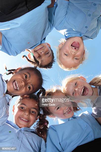 school children looking down - uniform stock pictures, royalty-free photos & images