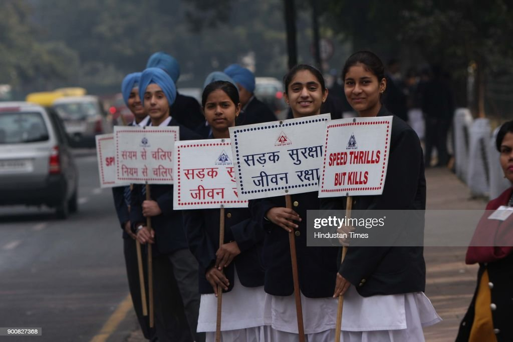 School children made a human chain to spread awareness among the people of Delhi to follow the traffic rules while driving on roads during Traffic Week at the India Gate Circle on January 8, 2008 in New Delhi, India.