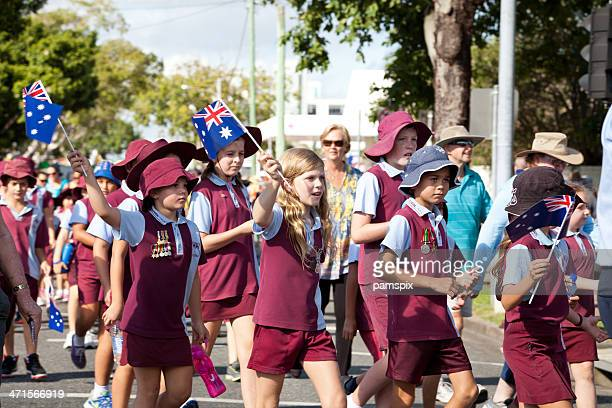 school children marching - anzac day stock pictures, royalty-free photos & images