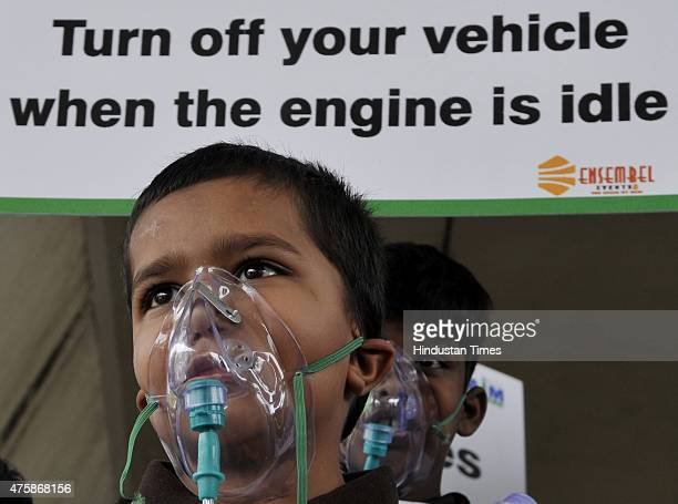 School children of Suraj Memorial High School wears an oxygen masks to raise awareness regarding the dangers of air pollution on the eve of World...