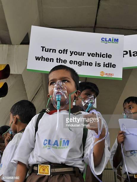 School children of Suraj Memorial High School wears an oxygen masks to raise awareness regarding the dangers of air pollution on the eve of World...