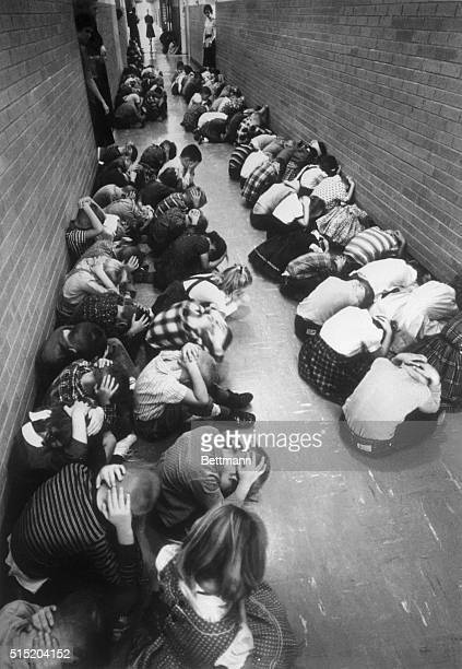 School children of Topeka, Kansas, USA, practice survival methods during a Civil Defense test. As sirens wail, some 31,000 students leave their desks...