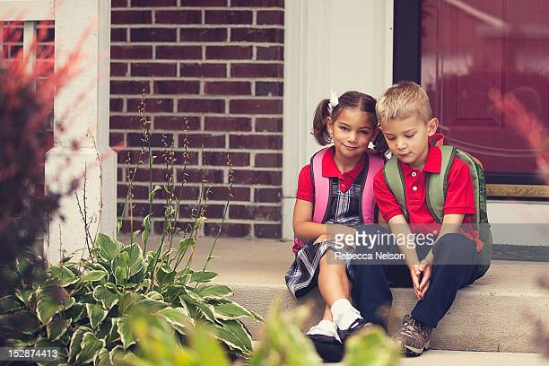 School children on front stoop