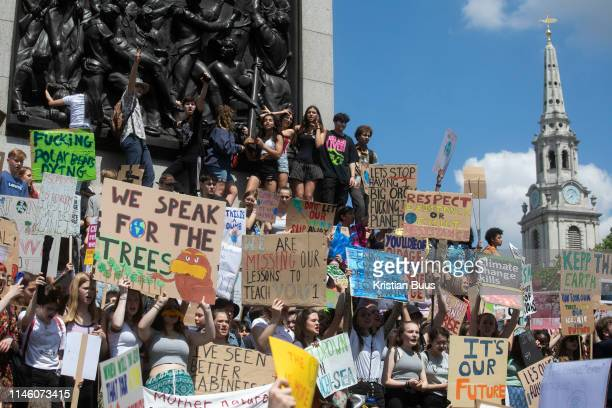 School children on school strike marching in protest against the governments lack of action on climate change May 24th 2019 Central London United...