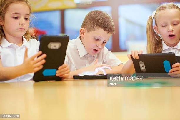 school children on tablets