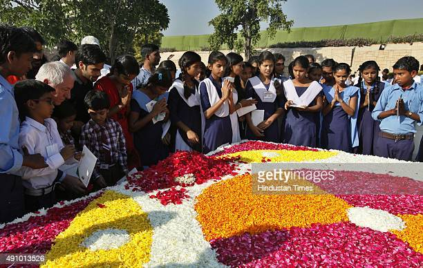 School children pay tribute to Mahatma Gandhi on his 146th birth anniversary at Rajghat on October 2 2015 in New Delhi India Ambassadors of France...