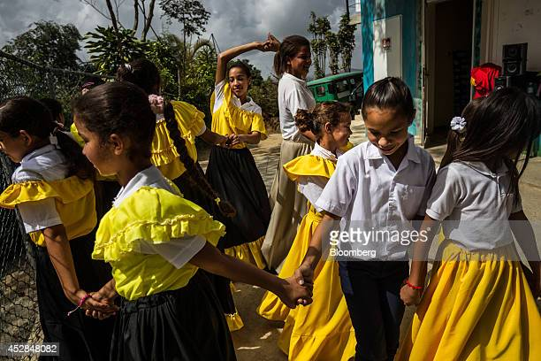 School children perform a traditional dance at the Culebrilla elementary school in Culebrilla Venezuela about 20 kilometers outside of Caracas on...