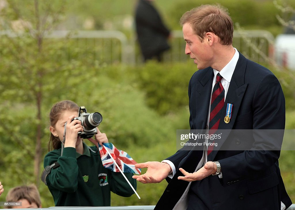 School children photograph Prince William as tours the National Memorial Arboretum where he launched an GBP8 million appeal to make the Alrewas site a world famous centre for remembrance on April 24, 2009 in Lichfield, England. Prince William was officially made the patron of the Future Foundations Appeal. During the poignant visit he viewed the names of his Sandurst platoon commander Major Alexis Roberts of the 1st Battalion The Royal Gurkha Rifles, killed in Afgahanistan and Intelligence Officer Joanna Dyer who trained in his platoon and killed near Basra.