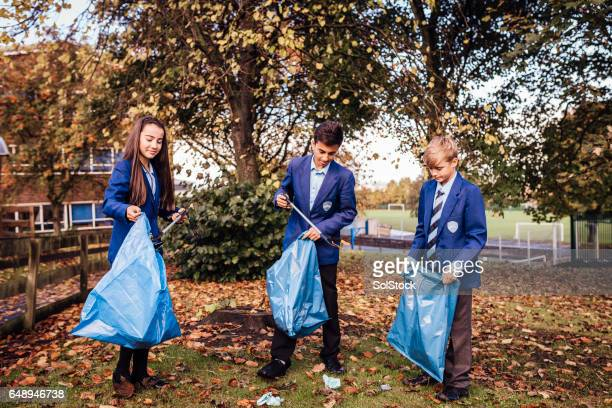 School Children Picking up Rubbish Around their School