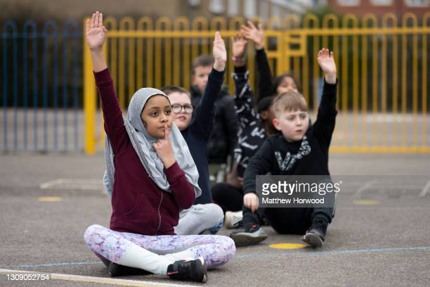 School children play outdoors in a playground during a PE lesson at St. Patrick's Catholic Primary School in Grangetown on March 19 in Cardiff,...