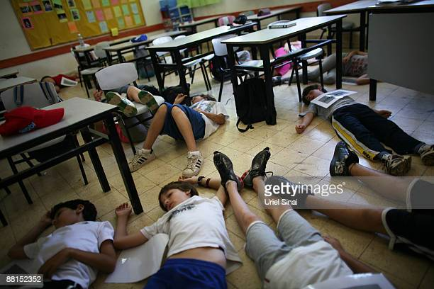 School children play wounded as part at a Home Front Command national exercise in a school on June 02 2009 in Tel Aviv Israel The exercise is...