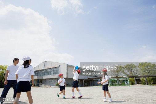 School children playing a ball game