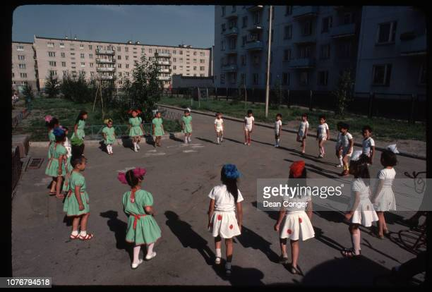 School Children Playing a Circle Game