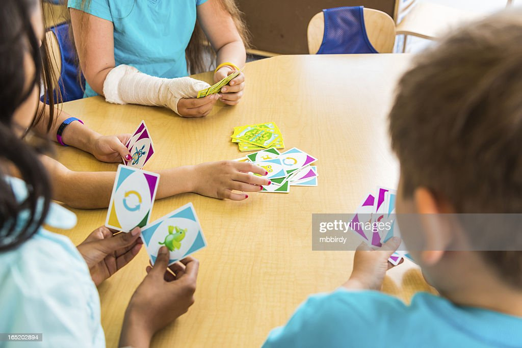 School children playing card game : Stock Photo