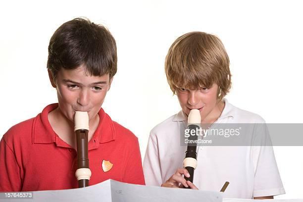 School children playing music Rekorder Bildung