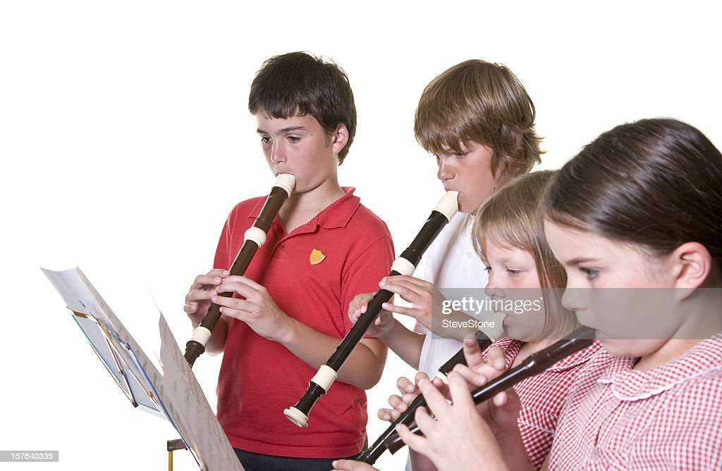 School children playing music recorders isolated education : Stock Photo