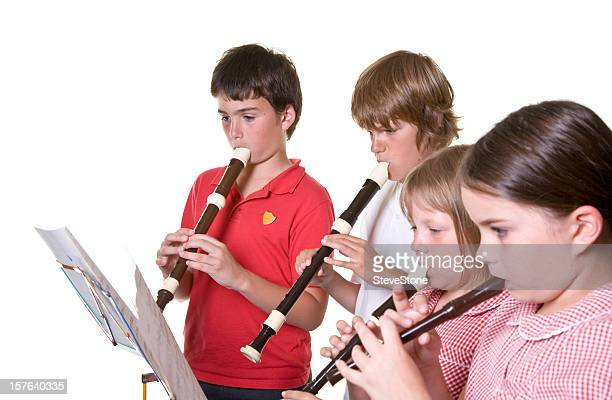 school children playing music recorders isolated education - recorder musical instrument stock photos and pictures