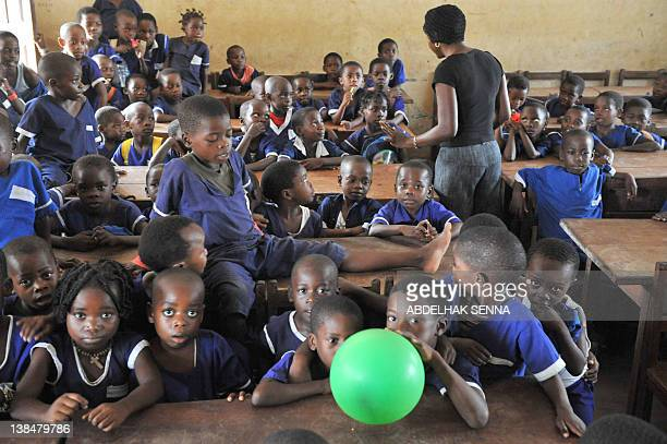 School children pose for the photographer on February 7, 2012 in Bata, one of the four cities hosting matches of the 2012 Africa Cup of Nations...