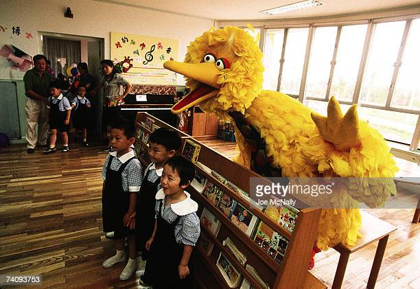School children pose in class for a photo with Big Bird of Sesame Street in October 1998 in a Shanghai classroom