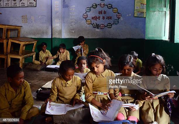 School children reading books while inside the classroom at a governmentrun school during International Literacy Day in Allahabad According to Indian...
