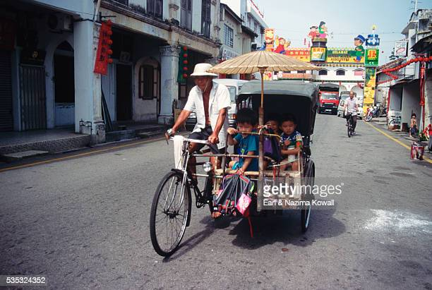 School Children Riding in Rickshaw
