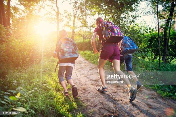 school children running to school - imgorthand stock photos and pictures