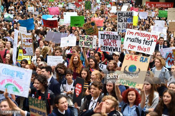 School children shout slogans during a strike and protest by students highlighting inadequate progress to address climate change in Sydney on March...