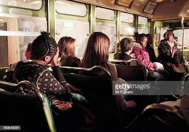 School children sit on the bus that civil rights icon Rosa Parks made famous when she refused to give up her seat February 4 2013 at The Henry Ford...