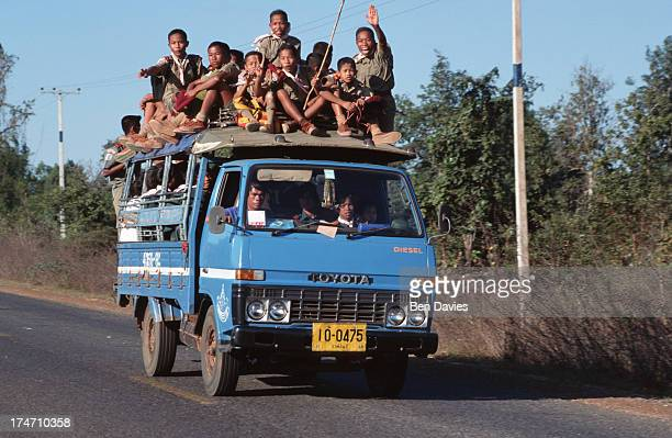 School children sitting on the roof of a truck are transported home in Yasothorn Province a remote area of northeast Thailand The truck is known as a...