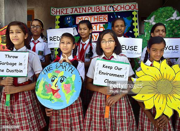 School children spreading social messages through paintings for saving the environment on the eve of 'World Earth Day' in Bikaner