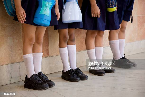 school children standing in a row - school girl shoes stock pictures, royalty-free photos & images