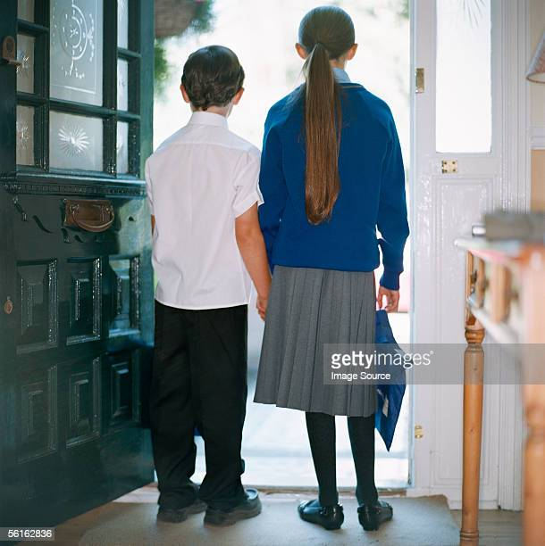 School children standing in doorway