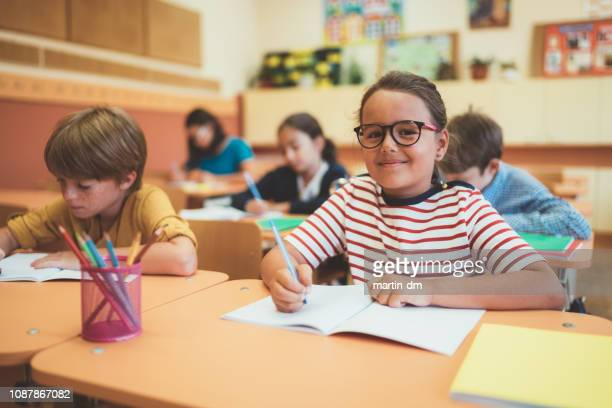 school children studying in class - spelling stock pictures, royalty-free photos & images