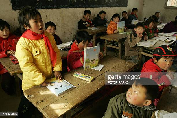 School children take class in a dilapidated classroom in Zhongjunlou Elementary School in Fenjing Town in central China's Anhui province 23 February...