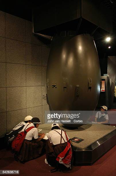 School children take notes around Fat Man a replica of the atomic bomb that fell on Nagasaki at the Nagasaki Atomic Bomb Museum | Location Nagasaki...