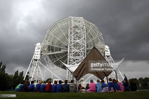 School children take part in a workshop next to The Lovell Telescope at Jodrell Bank on June 22 2011 in Holmes Chapel England Jodrell Bank Centre for...