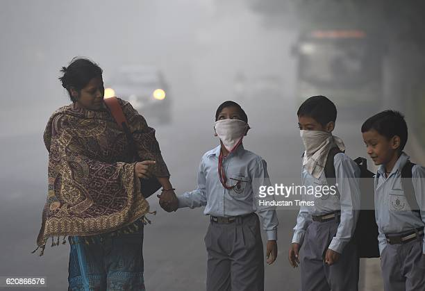 School children taking precautions as city covered under a blanket of heavy smog air quality deteriorated sharply overnight leading to poor...
