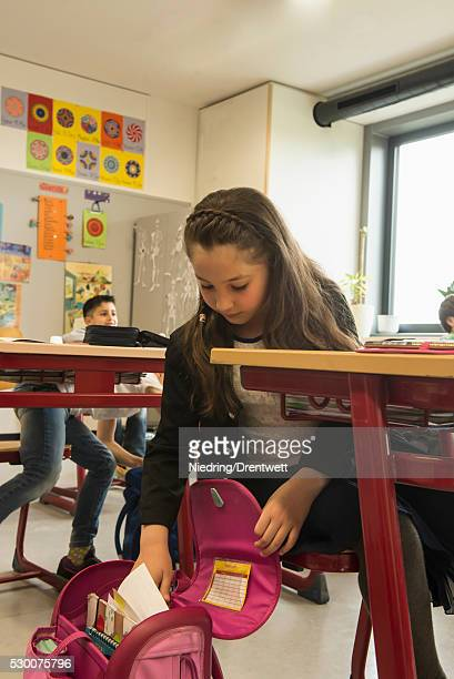 School children unpacking their bags in a classroom, Munich, Bavaria, Germany