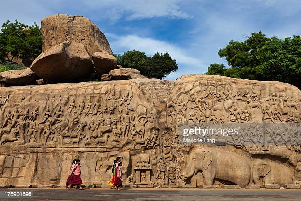 CONTENT] School children visiting Arjuna's Penance a giant openair carved monolithic rock built by the Pallava kings in the 7th and 8th centuries and...
