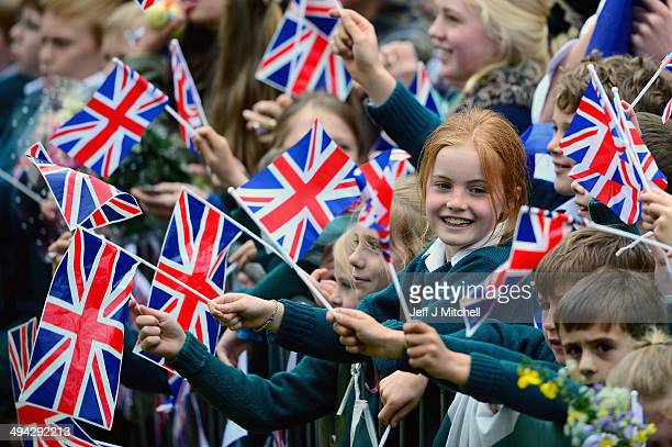 School children wait for Prince William Duke of Cambridge and Catherine Duchess of Cambridge to visit MacRosty Park on May 29 2014 in Crieff Scotland...
