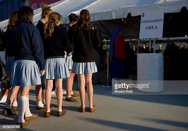School children wait outside a confession tent before Pope Benedict XVI celebrated a Mass at Nationals Park in Washington DC