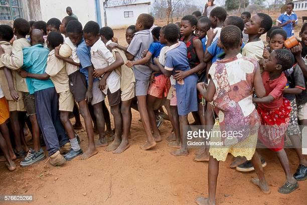 School Children Waiting for Nutritional Drink