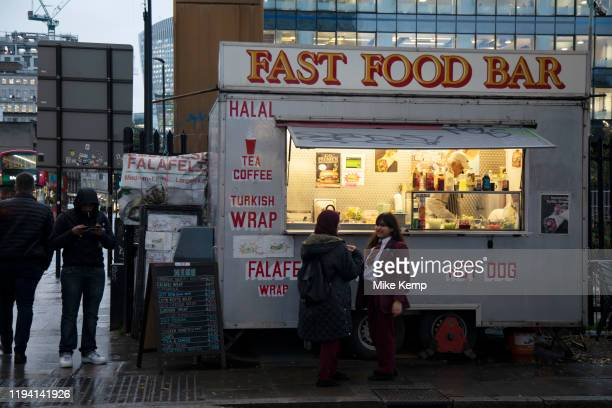 School children waiting outside a fast food bar at Aldgate on 26th November 2019 in London, England, United Kingdom. Eating fast food has been linked...