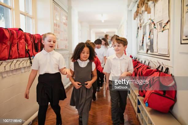 school children walk through the corridor - school building stock pictures, royalty-free photos & images