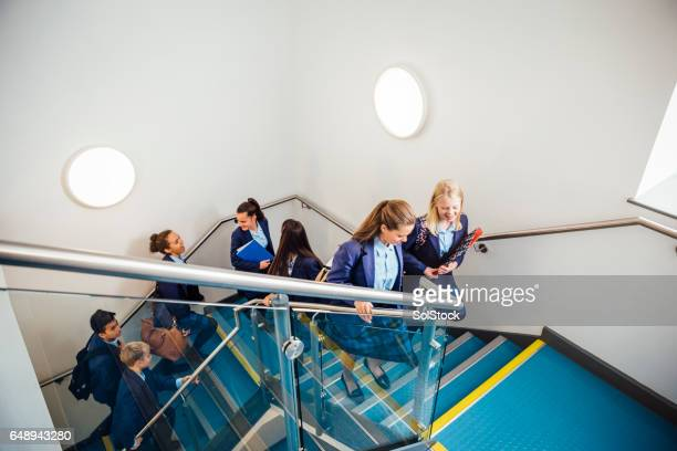 School Children Walking up School Staircase